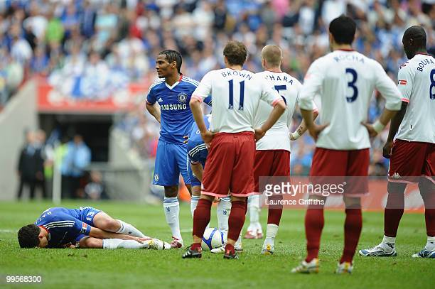 Michael Ballack of Chelsea hold his leg after being tackled and fouled by Kevin Prince Boateng of Portsmouth during the FA Cup sponsored by EON Final...