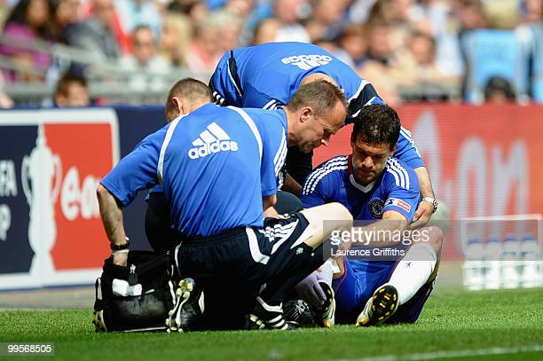 Michael Ballack of Chelsea is attended to by medical staff after being tackled and fouled by Kevin Prince Boateng of Portsmouth during the FA Cup...