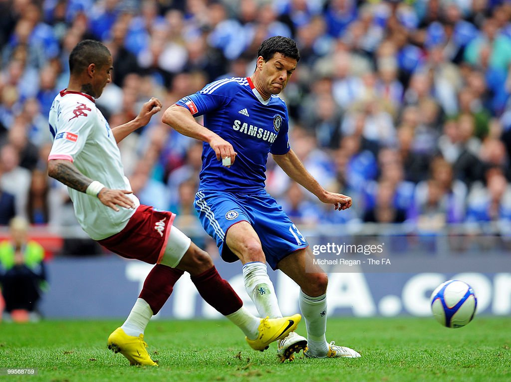 <a gi-track='captionPersonalityLinkClicked' href=/galleries/search?phrase=Michael+Ballack&family=editorial&specificpeople=202166 ng-click='$event.stopPropagation()'>Michael Ballack</a> of Chelsea is fouled by <a gi-track='captionPersonalityLinkClicked' href=/galleries/search?phrase=Kevin-Prince+Boateng&family=editorial&specificpeople=613049 ng-click='$event.stopPropagation()'>Kevin-Prince Boateng</a> of Portsmouth during the FA Cup sponsored by E.ON Final match between Chelsea and Portsmouth at Wembley Stadium on May 15, 2010 in London, England.