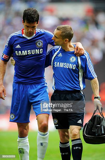 Michael Ballack of Chelsea is helped off the field following his injury during the FA Cup sponsored by EON Final match between Chelsea and Portsmouth...