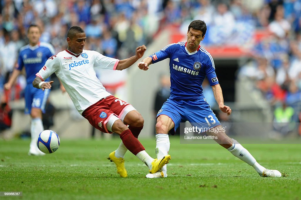 <a gi-track='captionPersonalityLinkClicked' href=/galleries/search?phrase=Michael+Ballack&family=editorial&specificpeople=202166 ng-click='$event.stopPropagation()'>Michael Ballack</a> of Chelsea is tackled and fouled by Kevin Prince Boateng of Portsmouth during the FA Cup sponsored by E.ON Final match between Chelsea and Portsmouth at Wembley Stadium on May 15, 2010 in London, England.
