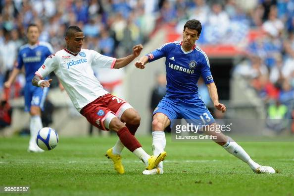 Michael Ballack of Chelsea is tackled and fouled by Kevin Prince Boateng of Portsmouth during the FA Cup sponsored by EON Final match between Chelsea...
