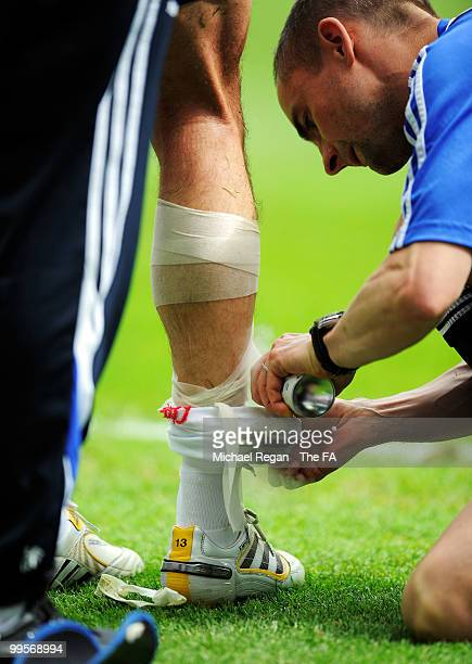 Michael Ballack of Chelsea receives treatment on an injury during the FA Cup sponsored by EON Final match between Chelsea and Portsmouth at Wembley...