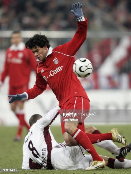 Michael Ballack of FC Bayern Munich and Jan Polak of 1 FC Nuremberg battle for the ball during the Bundesliga match between FC Bayern Munich and 1 FC...