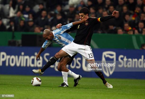 Michael Ballack of Germany and Juan Veron of Argentina compete for the ball during the International Friendly match between Germany and Argentina at...