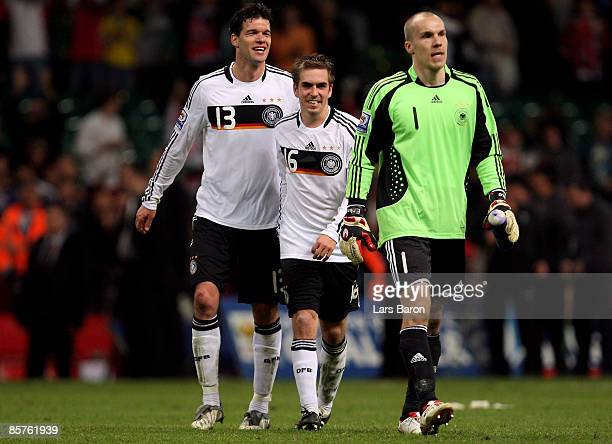 Michael Ballack of Germany celebrates with teammates Philipp Lahm and goalkeeper Robert Enke after winning the FIFA 2010 World Cup Group 4 Qualifier...