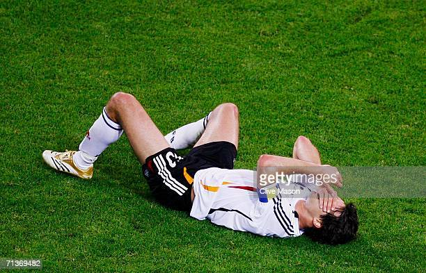 Michael Ballack of Germany clutches his face during the FIFA World Cup Germany 2006 Semifinal match between Germany and Italy played at the Stadium...