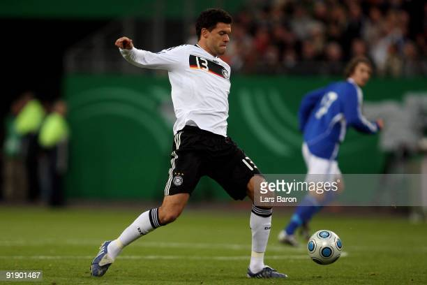 Michael Ballack of Germany runs with the ball during the FIFA 2010 World Cup Group 4 Qualifier match between Germany and Finland at the HSH Nordbank...