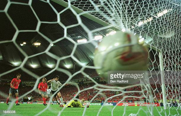 Michael Ballack of Germany scores the winning goal past goalkeeper Woon Jae Lee of South Korea as Germany win 10 to reach the World Cup final during...
