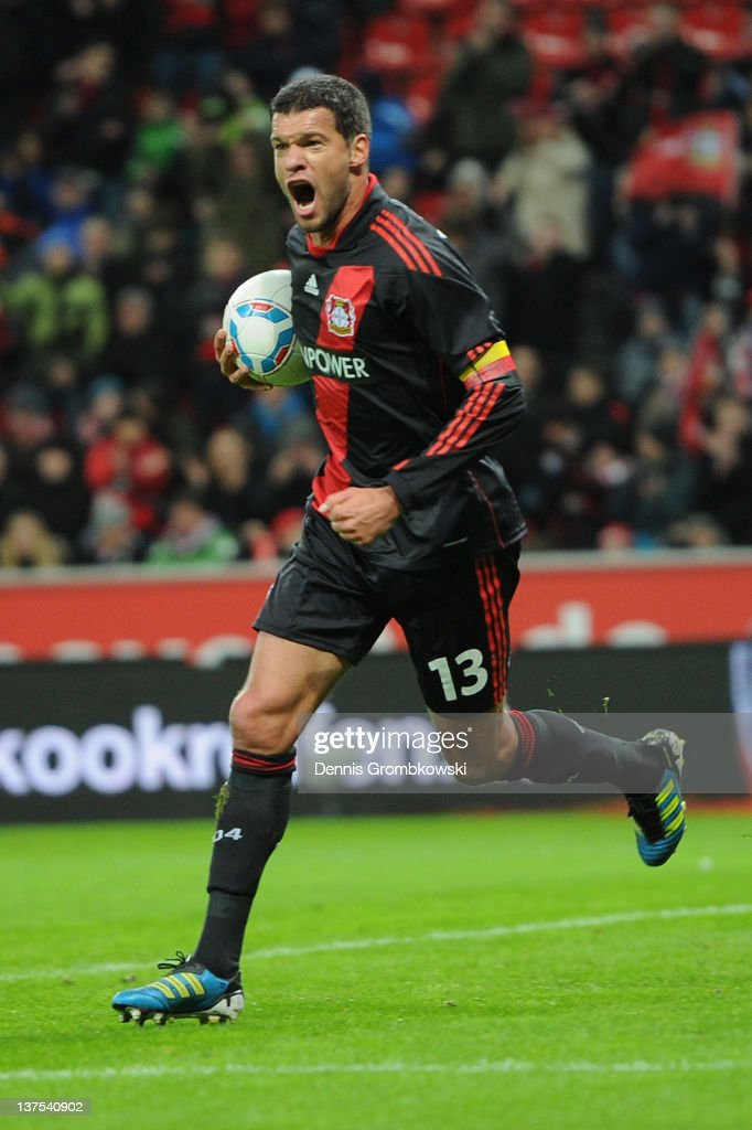 <a gi-track='captionPersonalityLinkClicked' href=/galleries/search?phrase=Michael+Ballack&family=editorial&specificpeople=202166 ng-click='$event.stopPropagation()'>Michael Ballack</a> of Leverkusen celebrates after Niko Bongert of Mainz has scored Leverkusen's opening goal during the Bundesliga match between Bayer 04 Leverkusen and FSV Mainz 05 at BayArena on January 22, 2012 in Leverkusen, Germany.