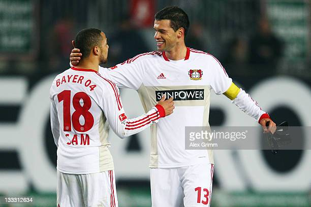 Michael Ballack of Leverkusen celebrates with team mate Sidney Sam after the Bundesliga match between 1 FC Kaiserslautern and Bayer 04 Leverkusen at...
