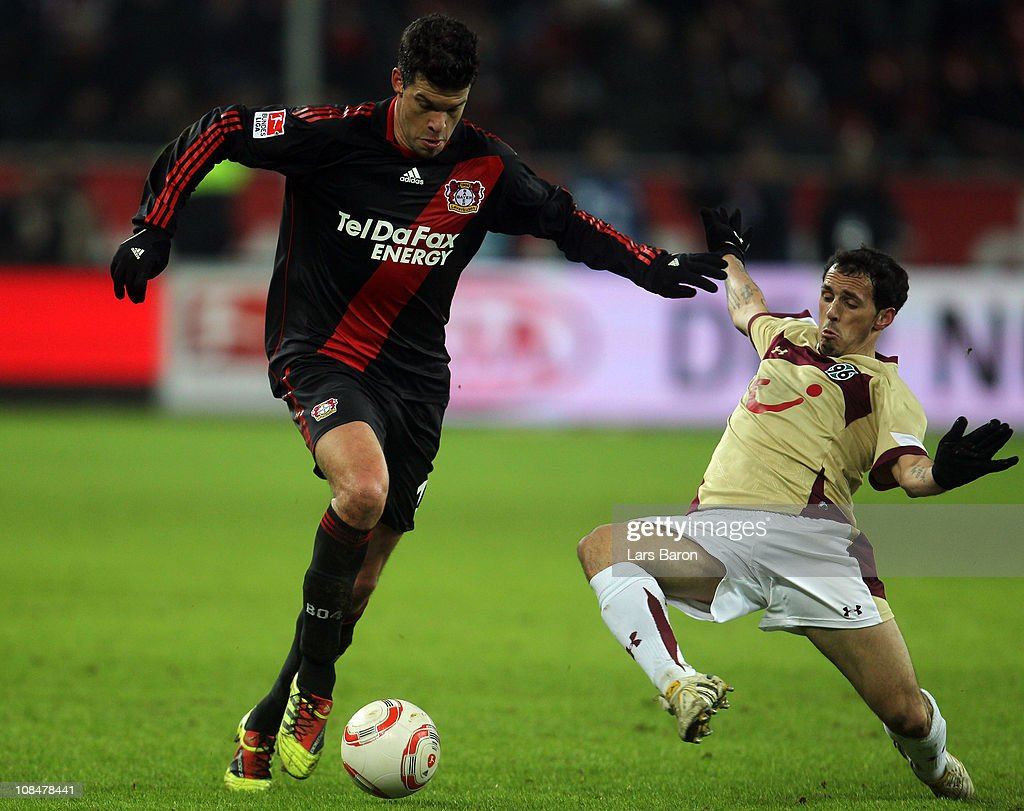 <a gi-track='captionPersonalityLinkClicked' href=/galleries/search?phrase=Michael+Ballack&family=editorial&specificpeople=202166 ng-click='$event.stopPropagation()'>Michael Ballack</a> of Leverkusen is challenged by <a gi-track='captionPersonalityLinkClicked' href=/galleries/search?phrase=Sergio+Pinto&family=editorial&specificpeople=683636 ng-click='$event.stopPropagation()'>Sergio Pinto</a> of Hannover during the Bundesliga match between Bayer Leverkusen and Hannover 96 at BayArena on January 28, 2011 in Leverkusen, Germany.