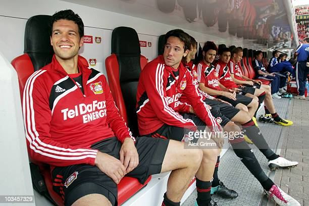 Michael Ballack of Leverkusen sits on the sustitution bench before the UEFA Europa League playoff first leg match between Bayer 04 Leverkusen and...