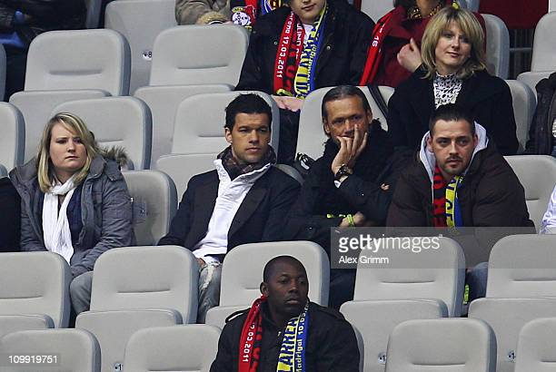 Michael Ballack of Leverkusen watches the UEFA Europa League round of 16 first leg match between Bayer Leverkusen and Villarreal from the main stand...