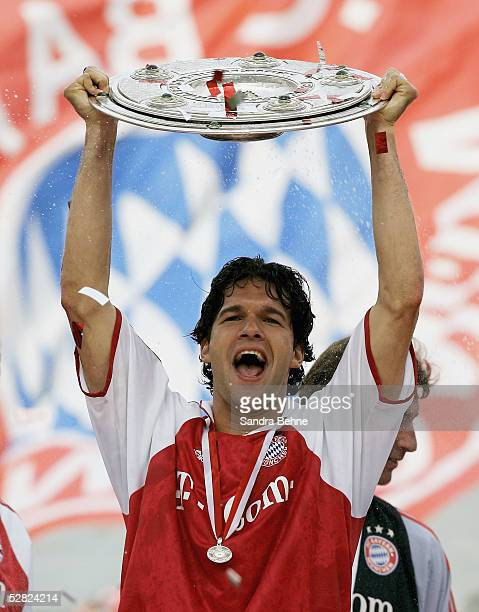 Michael Ballack of Munich celebrates with the trophy after the 1 Bundesliga match between FC Bayern Munich and 1FC Nuremberg at the Olympic Stadium...