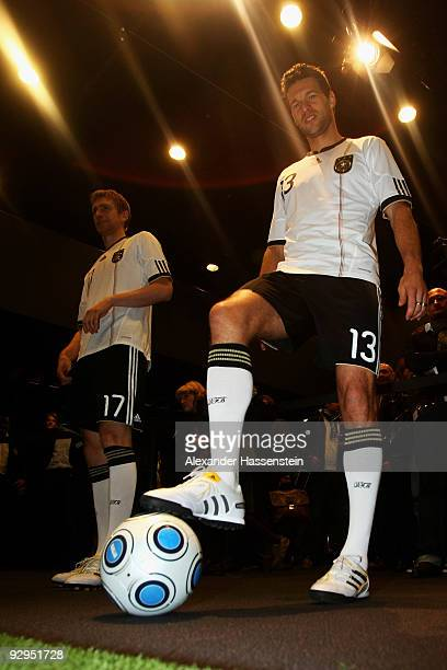 Michael Ballack poses with a ball after the presentation of the new German FIFA World Cup 2010 jersey 'Teamgeist' at the adidas Brand Center on...