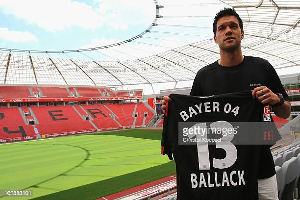Michael Ballack presents his jersey after the press conference of Bayer Leverkusen at the BayArena on July 14 2010 in Leverkusen Germany