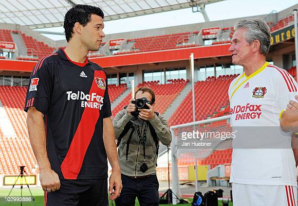 Michael Ballack talks to head coach Josef Jupp Heynckes during the Bayer Leverkusen team presentation at Bayarena Stadium on July 20 2010 in...