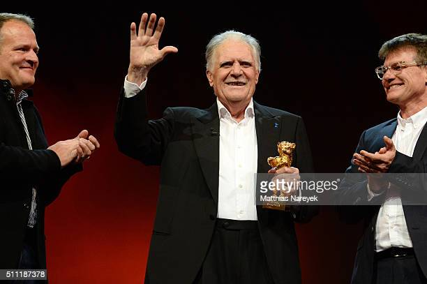Michael Ballhaus holds his Honorary Golden Bear next to his sons Florian and Jan Sebastian at the 'Hommage For Michael Ballhaus' during the 66th...