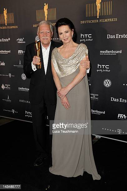 Michael Ballhaus poses with his award alongside Iris Berben as they attends the Lola German Film Award 2012 Winners Board at FriedrichstadtPalast on...
