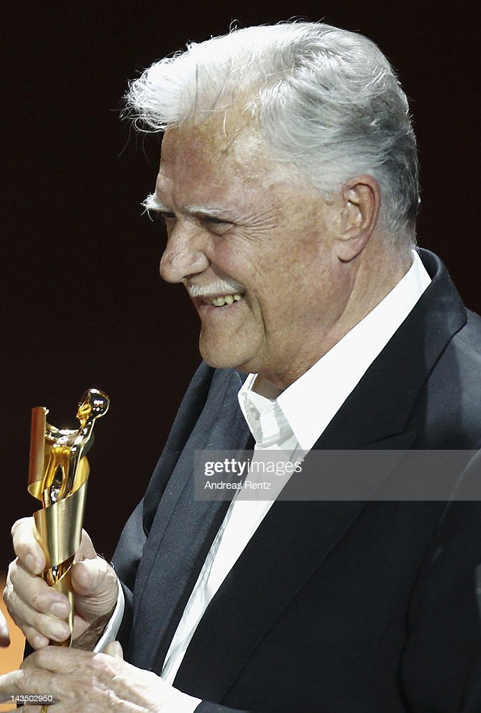 <a gi-track='captionPersonalityLinkClicked' href=/galleries/search?phrase=Michael+Ballhaus&family=editorial&specificpeople=236061 ng-click='$event.stopPropagation()'>Michael Ballhaus</a> smiles after receiving the 'Lifetime Achievement Award' during the Lola - German Film Award 2012 -Show at Friedrichstadt-Palast on April 27, 2012 in Berlin, Germany.