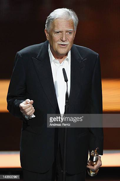 Michael Ballhaus smiles after receiving the 'Lifetime Achievement Award' during the Lola German Film Award 2012 Show at FriedrichstadtPalast on April...