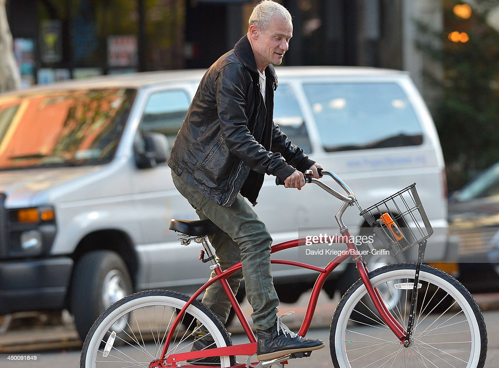 Michael Balzary better known as Flea is seen riding a bicycle on November 12 2013 in New York NY