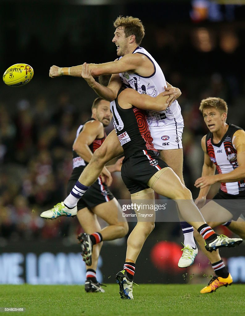 Michael Barlow of the Dockers handballs as he is tackled by David Armitage of the Saints during the round 10 AFL match between the St Kilda Saints and the Fremantle Dockers at Etihad Stadium on May 28, 2016 in Melbourne, Australia.