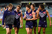 Michael Barlow of the Dockers is consoled for his shoulder injury by Tom Sheridan and Lee Spurr during the 2016 AFL Round 17 match between the...