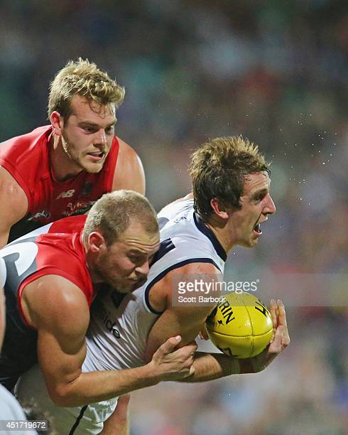 Michael Barlow of the Dockers is tackled by Jack Watts of the Demons during the round 16 AFL match between the Melbourne Demons and the Fremantle...