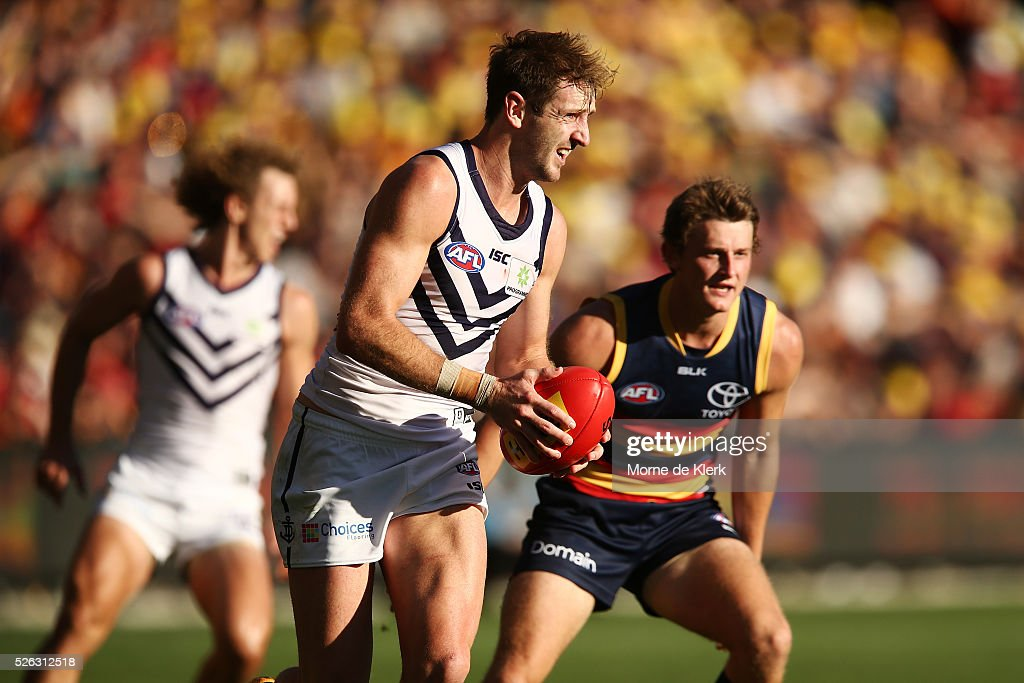 Michael Barlow of the Dockers runs with the ball during the round six AFL match between the Adelaide Crows and the Fremantle Dockers at Adelaide Oval on April 30, 2016 in Adelaide, Australia.