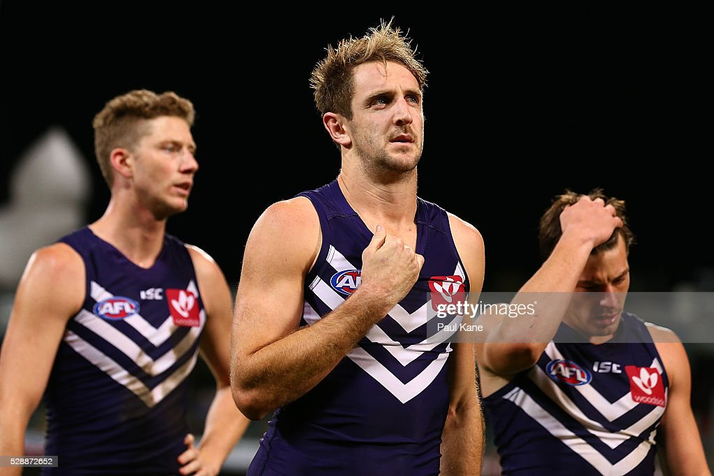 Michael Barlow of the Dockers walks from the ground after being defeated during the round seven AFL match between the Fremantle Dockers and the Greater Western Sydney Giants at Domain Stadium on May 7, 2016 in Perth, Australia.