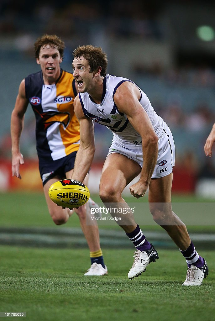 Michael Barlow of the Fremantle Dockers looksto handpass during the round one NAB Cup match between the West Coast Eagles and the Fremantle Dockers at Patersons Stadium on February 16, 2013 in Perth, Australia.