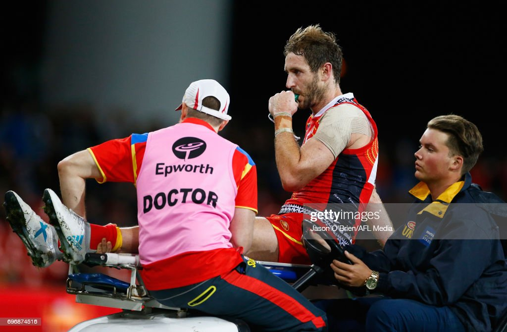 Michael Barlow of the suns suffers an injury during the round 13 AFL match between the Gold Coast Suns and the Carlton Blues at Metricon Stadium on June 17, 2017 in Gold Coast, Australia.