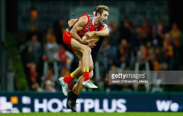 Michael Barlow of the suns takes a mark during the round 13 AFL match between the Gold Coast Suns and the Carlton Blues at Metricon Stadium on June...
