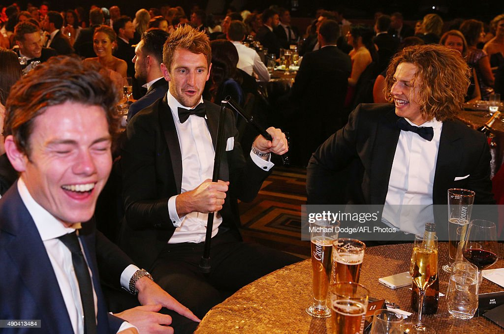 Michael Barlow reacts after snapping the walking stick of teammate Nat Fyfe (R) of the Dockers who celebrates winning the 2015 Brownlow Medal at Crown Palladium on September 28, 2015 in Melbourne, Australia.