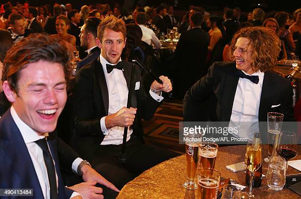 Michael Barlow reacts after snapping the walking stick of teammate Nat Fyfe of the Dockers who celebrates winning the 2015 Brownlow Medal at Crown...