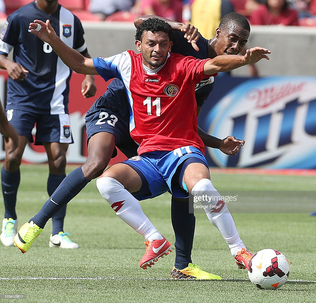 Michael Barrantes #11of Costa Rica and Tyrone Pandy #23 of Belize battle for the ball during the first half of a CONCACAF Gold Cup match July 13, 2013 at Rio Tinto Stadium in Sandy, Utah.