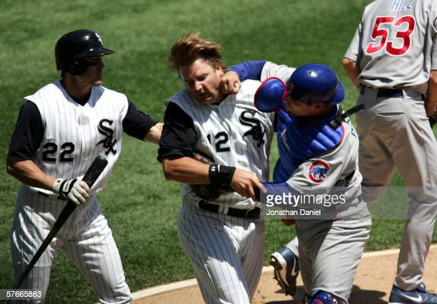 Michael Barrett of the Chicago Cubs punches AJ Pierzynski of the Chicago White Sox after a second inning collision as Scott Podsednik steps in on May...