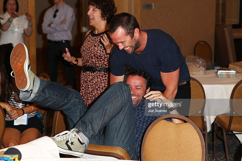 Michael Bassett and Sullivan Stapleton (R) attend the Strike Back press line at Comic-Con International 2013 - Day 1 on July 18, 2013 in San Diego, California.