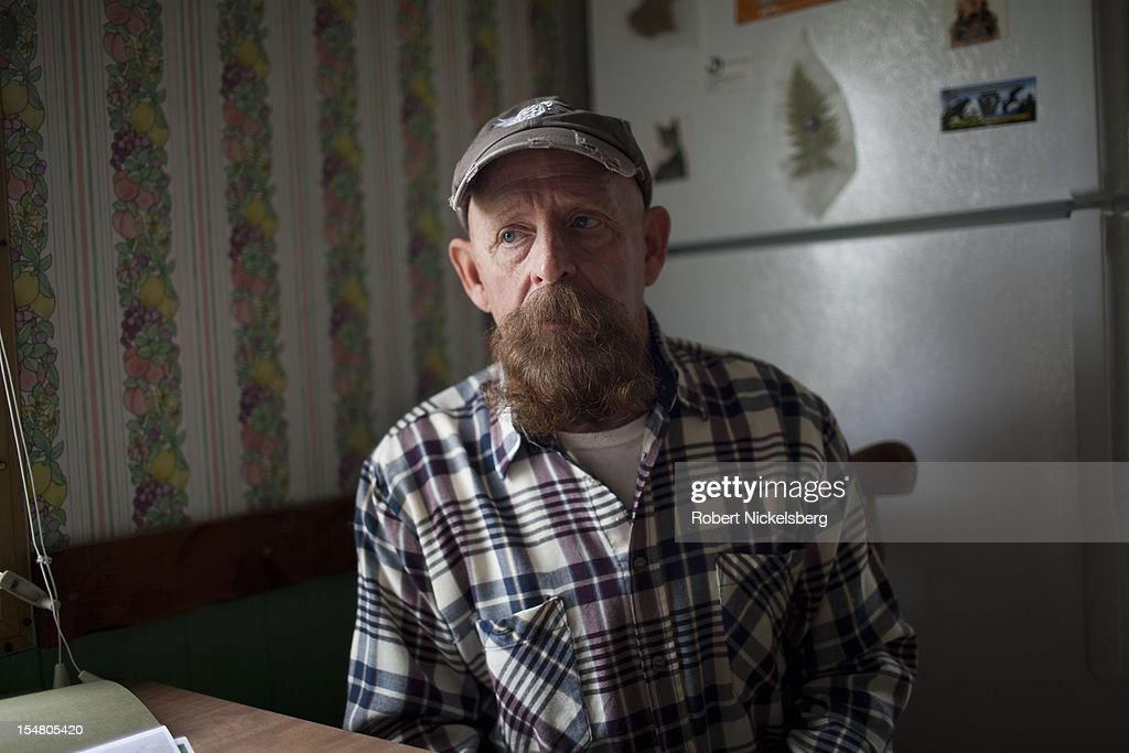 Michael Bastion sits in his home September 10, 2012 located in the Marcellus Shale field in East Troy, Pennsylvania. Bastion's property is adjacent to a natural gas well drilled by Nomac Drilling Company which had major pressure issues at the well and caused a viscous liquid to pour out and spill onto his property in 2010. Bastion's water well and water supply was contaminated from the 2010 leak. The leakage continued for two weeks until Bastion reported it. The cleanup effort lasted for several months. Nomac Drilling is owned by Chesapeake Energy. Hydrofracking is a controversial drilling method which pumps millions of gallons of water, sand and chemicals into horizontally drilled wells to stimulate the release of the gas. The Marcellus Shale gas field stretches diagonally across West Virginia, Ohio, Pennsylvania and New York State. The environmental impact is a politically sensitive issue in a resource dependent state.
