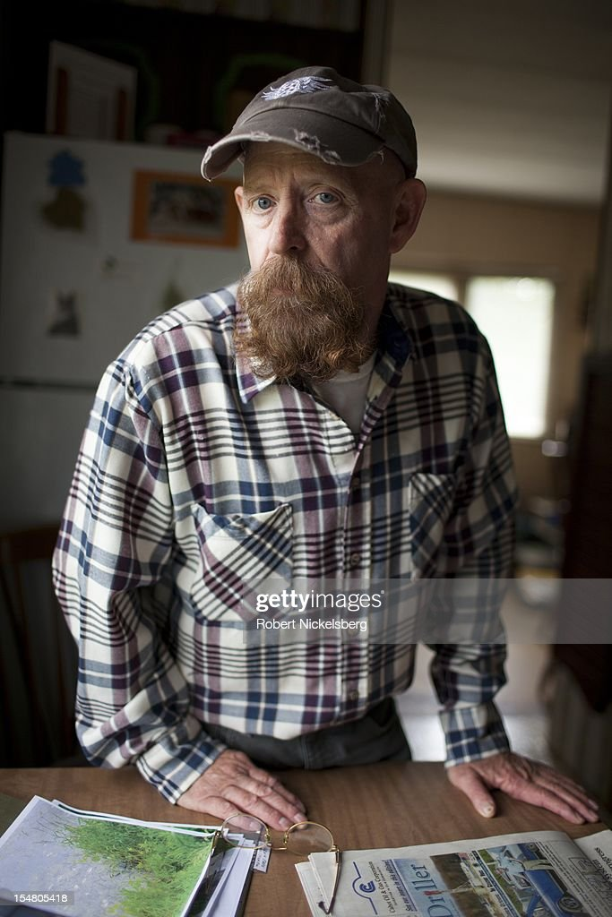 Michael Bastion stands in his home September 10, 2012 in the Marcellus Shale field in East Troy, Pennsylvania. Bastion's property is adjacent to a natural gas well drilled by Nomac Drilling Company which had major pressure issues at the well and caused a viscous liquid to pour out and spill onto his property in 2010. Bastion's water well and water supply was contaminated from the 2010 leak. The leakage continued for two weeks until Bastion reported it. The cleanup effort lasted for several months. Nomac Drilling is owned by Chesapeake Energy. Hydrofracking is a controversial drilling method which pumps millions of gallons of water, sand and chemicals into horizontally drilled wells to stimulate the release of the gas. The Marcellus Shale gas field stretches diagonally across West Virginia, Ohio, Pennsylvania and New York State. The environmental impact is a politically sensitive issue in a resource dependent state.