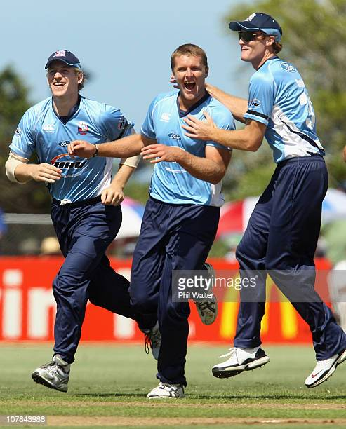 Michael Bates of the Aces is congratulated by Jimmy Adams and Martin Guptill on his wicket of Ian Blackwell of the Stags during the final of the HRV...