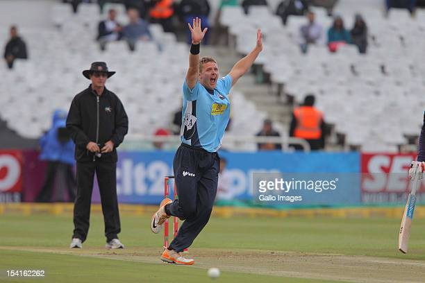 Michael Bates of the Auckland Aces celebrates during the Karbonn Smart CLT20 match between Kolkata Knight Riders and Auckland Aces at Sahara Park...
