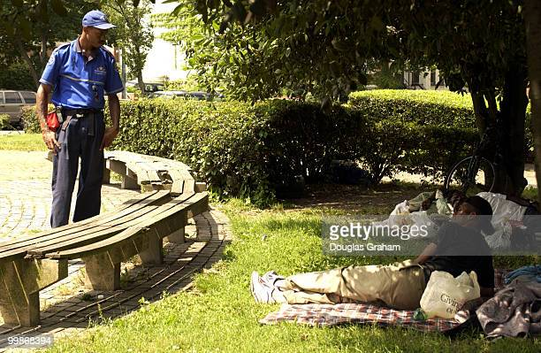 Michael Baxter a homeless Outreach / Safety Ambassador with the Capitol Hill Business Improvement District talks with some of the Hill's homeless...