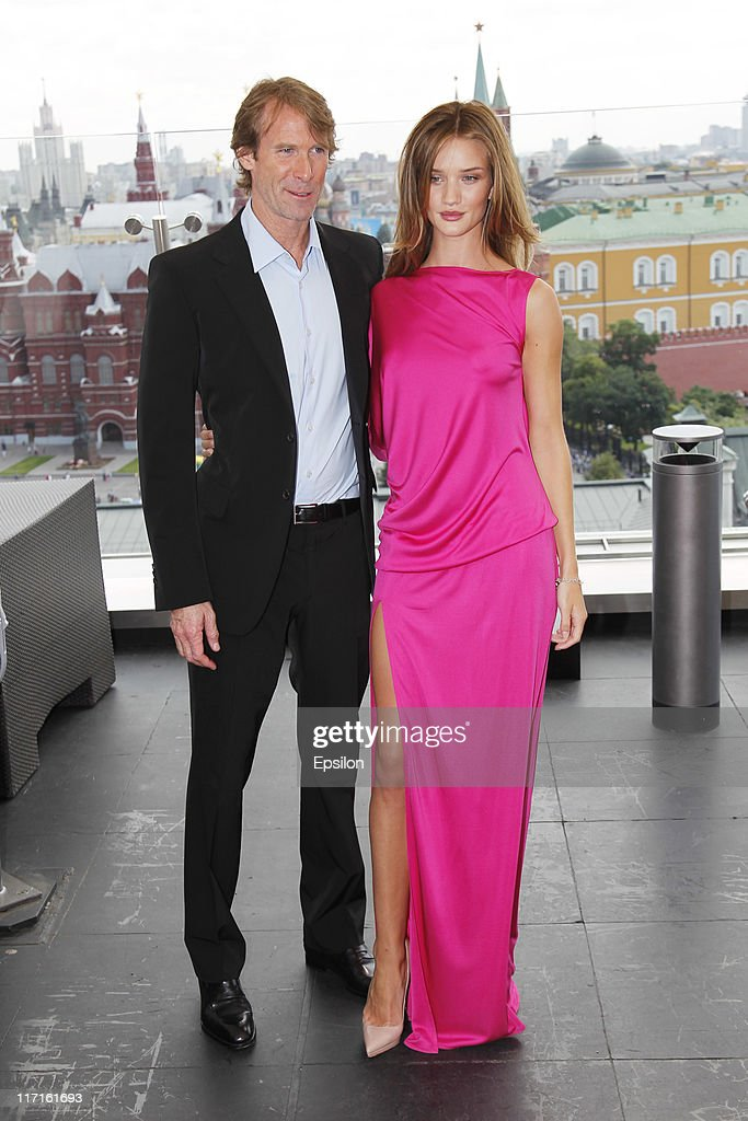 Michael Bay and Rosie Huntington-Whiteley poses for a photocall before global premiere of 'Transformers 3' movie on the roof of the Ritz Carlton hotel on June 23, 2011 in Moscow, Russia.