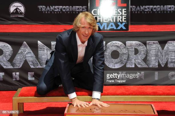 Michael Bay places his hands in cement during his Hand and Footprint Ceremony at TCL Chinese Theatre IMAX on May 23 2017 in Hollywood California
