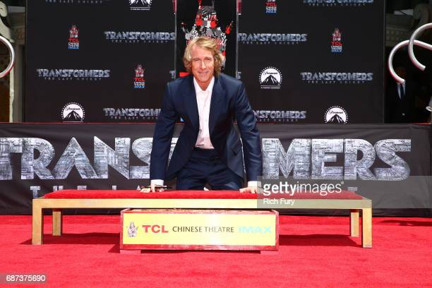 Michael Bay puts his hands in cement during his Hand and Footprint Ceremony at TCL Chinese Theatre IMAX on May 23 2017 in Hollywood California