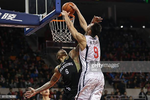 Michael Beasley of Shandong Golden Stars defends against Yi Jianlian of Guangdong Southern Tigers during the Chinese Basketball Association 15/16...