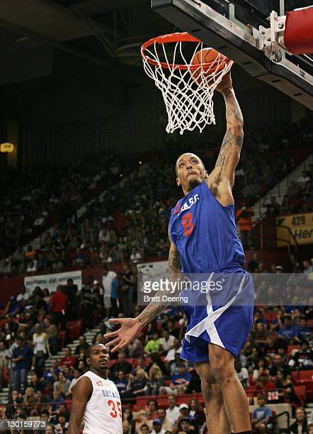 Michael Beasley of Team Blue goes to the net during the US Fleet Tracking Basketball Invitational charity basketball game October 23 2011 at the Cox...